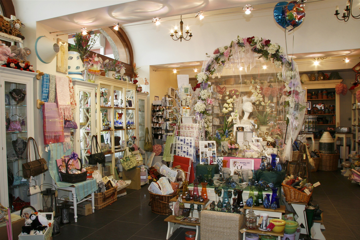 I bought one of my first Christmas presents for my mom at Coach House Gifts, a shop that looked similar to this.